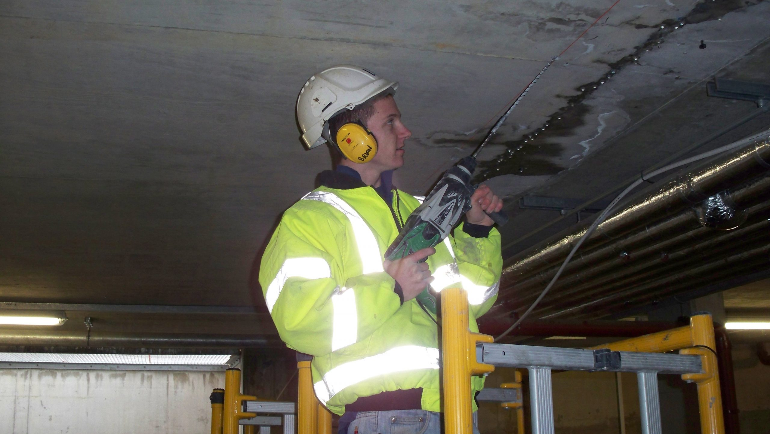 MacLennan technician drilling for resin injection installation